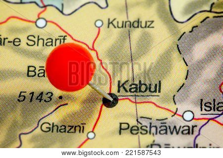 Close-up of a red pushpin on a map of Kabul, Afghanistan.
