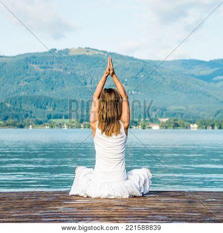 serenity and yoga practicing at the lake Garda. Italy