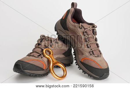 Outdoors shoes for man for hiking, climbing and figure eight descender,  studio shoot on white background