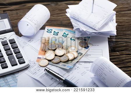High Angle View Of Currency With Calculator And Pen On Receipt poster