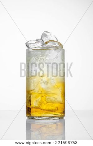 Glass with juice and ice on the white background.
