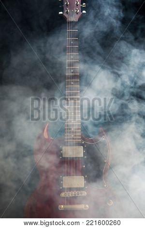 electric guitar in smoke, closeup view