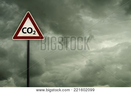 co2 on roadsign under dark cloudy sky