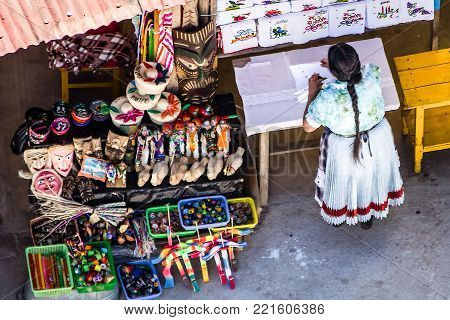 An Indigenous Woman Selling Souvenirs at a Market in Janitzio Island, Michoacan, Mexico