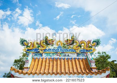 Chinese New Year.Chinese dragon statue on top of Chinese temple roof