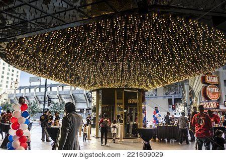 DOWNTOWN LAS VEGAS, LAS VEGAS, NEVADA, USA- NOVEMBER 11, 2017: People at a party outside Oscar's Steakhouse Las Vegas at Downtown Las Vegas, across from the Freemont Street Experience