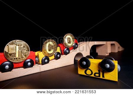 ICO Initial coin offering method of funding startups vs IPO. New funding opportunities for startups and other projects using block chain technology. An inverted car with the inscription IPO is a symbol of competition with the ICO.