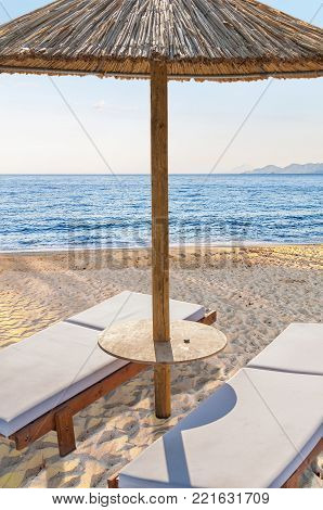 Two Empty Sun Bed At Big Sandy Beautiful Beach For Relaxation Near Blue Sea