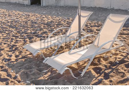 Two Sun Bed On Pebble Sandy Beach Ona A Sunny Day Close