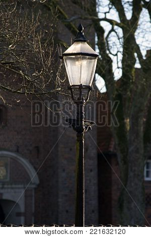 Old lamp from royal town Ribe in Denmark a cold and clear January day.  Denmark's oldest city.