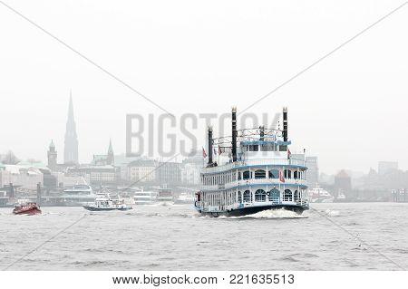 Hamburg, Germany - November 21, 2010: The historic cruise ship Louisiana Star. Retro steamship floats Elbe river in Hamburg on a foggy day.