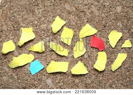 Lot of color paper scraps on wooden background