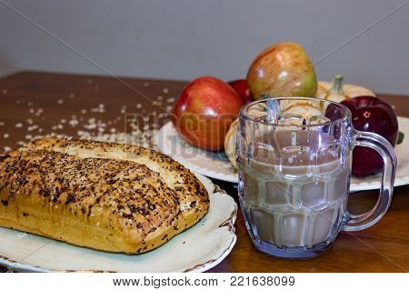 breakfast display of apples coffee and bread