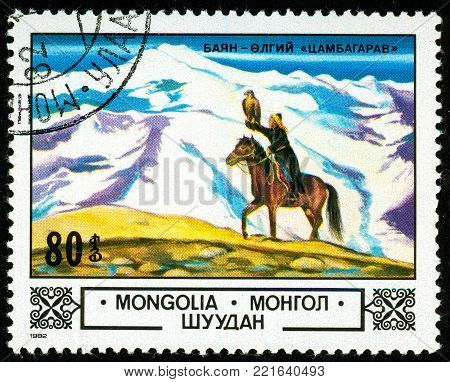 Ukraine - circa 2018: A postage stamp printed in Mongolia shows Falcon hunting. A rider on a horse holds a falcon on his hand. Series: Animals and landscapes. Series: Flora. Circa 1982.