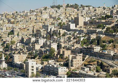 AMMAN, JORDAN - AUGUST 18, 2012: View to the residential area buildings of the city in Amman, Jordan.
