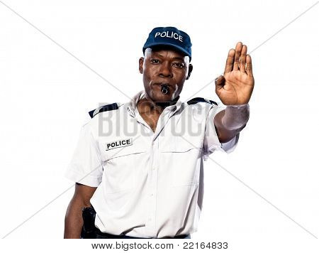 Portrait of an afro American police officer making a stop gesture in studio on white isolated background