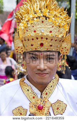 Balinese Man Participates In A Street Ceremony, During A Pre-election Rally, The Indonesian Democrat