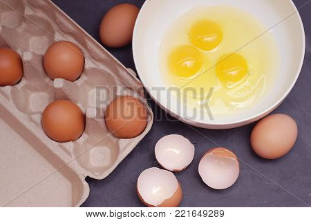 Whipping Chicken Eggs. Yolks and Egg for Food Prearation