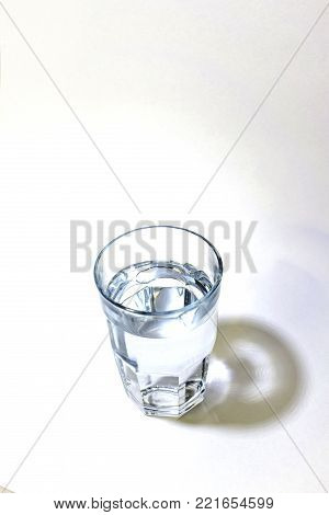 One tall glass of clean fresh water on a white background.