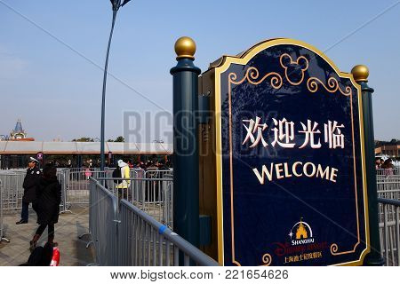 SHANGHAI, CHINA-JAN 08, 2018: Welcome sign in front of main entrance in Disneyland park in Shanghai, China. Shanghai Disneyland Park is a theme park located in Pudong, Shanghai