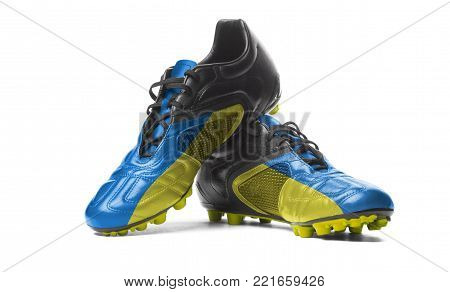 The Ukrainian flag painted on football boots. Isolated on white background.