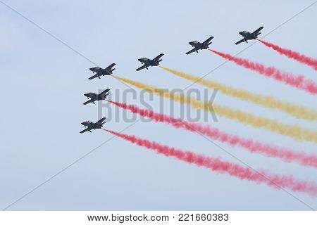 ROME - JUNE 29: The spanish acrobatic team Patrulla Aguila perform at the Rome International Air Show on June 29, 2014 in Rome, Italy