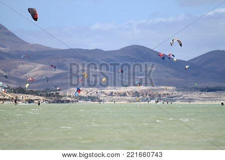 COSTA CALMA, SPAIN - MAY 13, 2017: Kitesurfers in Sotavento Beach in Fuerteventura. Canary Islands, Spain