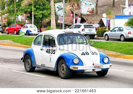 Acapulco, Mexico - May 30, 2017: Taxi car Volkswagen Beetle in the city street.
