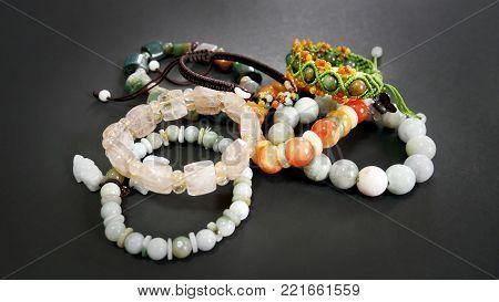 Rutile Quartz and Jade Beaded Bracelets on Black Background