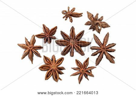 Closeup Of Several Star Anises (star Aniseed Or Chinese Star Anise) Viewed From Above, Isolated On W