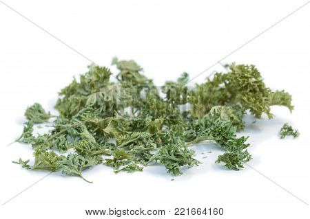 Close-up Of Handful Of Dried Parsley, Isolated On White Background.