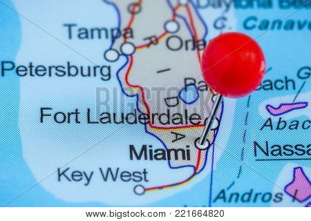 Close-up of a red pushpin on a map of Miami, USA.