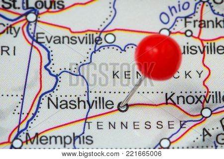 Close-up of a red pushpin in a map of Nashville, USA.