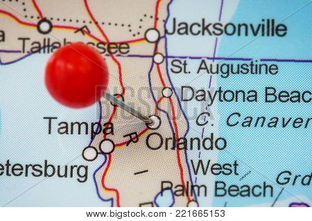 Close-up of a red pushpin in a map of Orlando, USA.