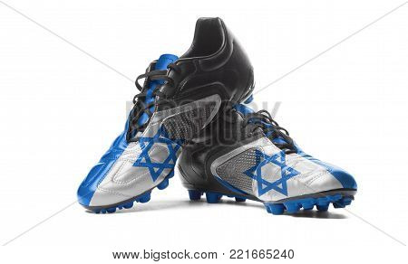 The Israeli flag painted on football boots. Isolated on white background.