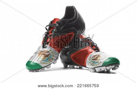 The Mexican flag painted on football boots. Isolated on white background.