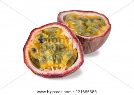 Close-up of a split passion fruit (passionfruit, purple granadilla (Passiflora edulis)) with shadow, isolated on white background.