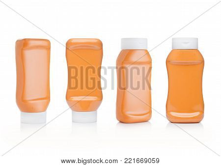 Plastic container with meat spicy sauce on white background