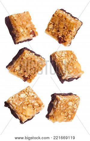 Protein cereal energy mini bars nuts and chocolate for breakfast on white background
