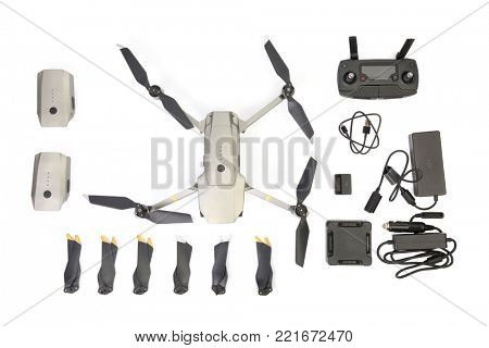 BUDAPEST, HUNGARY - DECEMBER 10, 2017: Drone on white background, DJI Mavic Pro Platinum Fly Mor Combo with accessories. DJI is one of the most popular manufacturers of consumer drones