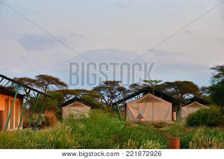 Amboseli, Kenya - Aug 23, 2010: Accommodation units in Sentrim Amboseli Tented Camp Luxury Lodge, one from the most popular place to stay during safari. Kilimanjaro mountain on background