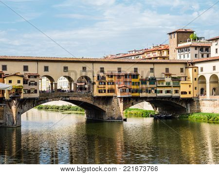 View on famous Ponte Vecchio bridge from the other side of the Arno river in Florence, Italy