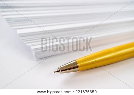 ball point pen and blank paper, tools of the writer, white background