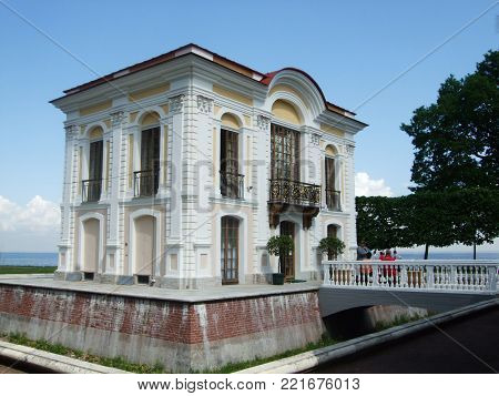 Petergof, Saint Peterburg, Russia - JUNE 12, 2013: White little Holiday house with bridge overlooking the bay