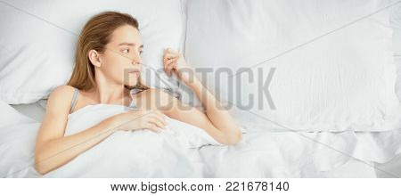 Woman in bed, single, alone, sad, relax
