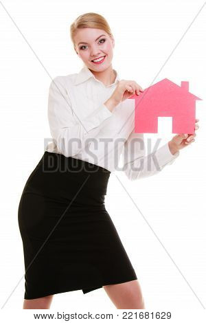 Woman real estate agent holding red paper house. Property business and accomodation or loan concept  isolated on white background