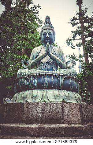 Buddha statue in Senso-ji Kannon temple, Tokyo, Japan