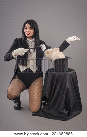Beautiful Woman Magician With Rabbit In Hat