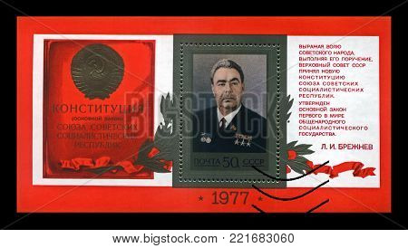 MOSCOW, USSR - CIRCA 1977: Leonid Brezhnev - politician leader of the Communist party of the Soviet Union, Constitution law of the USSR, circa 1977. Vintage stamp isolated on black background.