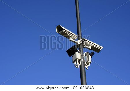 security monitoring camera on pole and blue sky, France